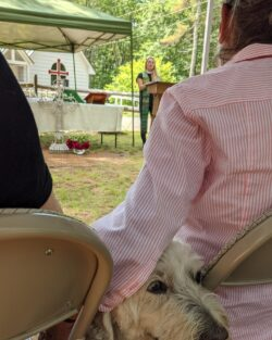 Photo of dog joining in an outside church service at St. Giles'